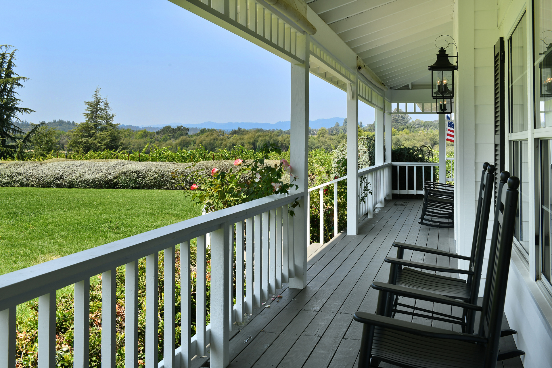 Rocking chairs on porch looking at view