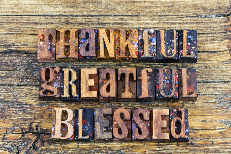 Letterpress type wood block thankful greatful helpful blessed religious message inspiration thank you positive help concept.